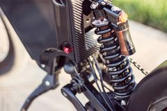 Electric bike rear shock absorber close up. Ebike bicycle environmentally friendly eco e-mountainbike transport. Healthy lifestyle stock photos