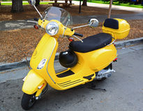 Electric Bike Scooter. Yellow Electric Bike Scooter on street royalty free stock photo