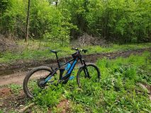 Electric bike in the woods. Electric hybrid bike ready to be ridden in the nature stock photos