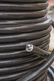 Electric black industrial underground cable on large wooden reel Stock Photography