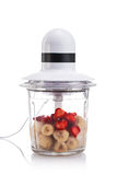 Electric Blender filled with different fruits isolated Royalty Free Stock Photography