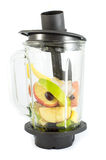 Electric blender with fruits Stock Images