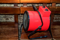 Electric blow heater. Modern red electric blow heater in room Royalty Free Stock Photos
