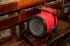 Electric blow heater. Modern red electric blow heater in room Royalty Free Stock Photography