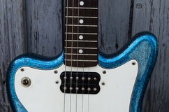 Electric blue guitar. Close up detail of an electric blue guitar Royalty Free Stock Photos
