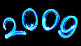 Electric blue number 2009. Blue number 2009 light painted with LED lights Royalty Free Stock Photography