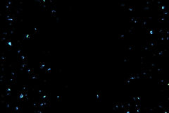 Electric blue sparkle background with particles flowing on black, holiday festive. Concept Stock Images