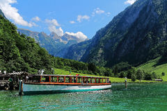 Electric boat in alpine landscape of lake Königssee Stock Image