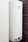 Electric Boiler wall water heater in bathroom. Stock Image