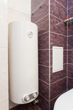 Electric Boiler wall water heater in bathroom. Royalty Free Stock Image