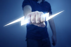 Electric Bolt. A man holding a stylized electric bolt Stock Photo