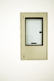 Electric box. Electric box built in white wall of apartment Royalty Free Stock Photography