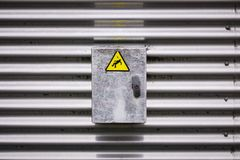 Electric box with a danger sign sticker royalty free stock photo