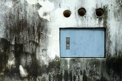 Electric Box on Old Grunge Concrete Wall. royalty free stock images