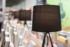 Electric brown table reading lamp and books in a library Royalty Free Stock Image