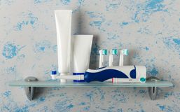 Electric brush and replaceable nozzles of different colors, rinse aid and toothpaste. On glass shelf Stock Images