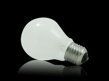 Electric bulb. Standard electric bulb isolated on black background Stock Image