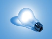 Electric bulb on a blue Royalty Free Stock Photos