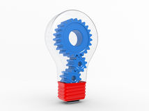 Electric bulb and gears inside Stock Image