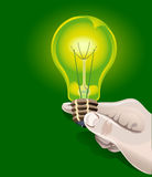 Electric bulb in hand Royalty Free Stock Images