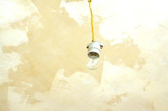 Electric bulb hangs from ceiling Stock Image