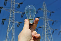 Electric bulb and power lines Stock Photo