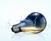 Electric bulb and windmill generators Stock Photo