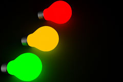 Electric bulbs arranged as traffic lights Royalty Free Stock Image