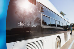 Electric bus on street. Electric vehicle bus stands at the charger royalty free stock photo