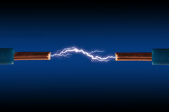 Electric cable. With sparks on a black background Royalty Free Stock Image