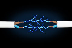 Electric cable. With sparks on black background Royalty Free Stock Image