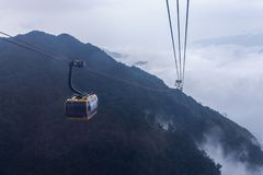 Electric cable car go to Fansipan mountain peak the highest mountain in Indochina, At 3,143 metres in Sapa, Vietnam.  stock photo