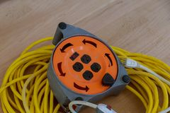 Electric cable and extension cord on the construction works. Electriable and extension cord on the construction works on a cable stock images