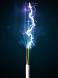 Electric cable with glowing electricity lightning Stock Photography