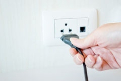 Electric cable with hand and Electrical Outlet Stock Photo