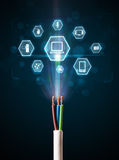 Electric cable with multimedia icons. Glowing multimedia icons coming out of electric cable Stock Images
