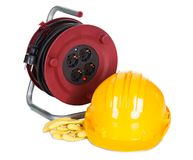 Electric cable reel, helmet and rubber gloves Royalty Free Stock Photography