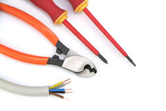 Electric cable with tools on a white background Stock Photography