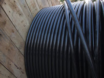 Electric cable in wooden coil Royalty Free Stock Image