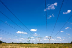 Electric cables. High voltage pylons, electrical distribution, overhead line Stock Photography