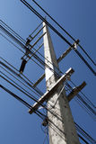 Electric Cables. Tower against deep blue sky stock images