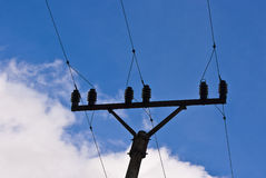 Electric cables. And pylon against the blue sky stock image