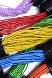 Electric cables in corrugated plastic pipes. On metal surface Stock Photo