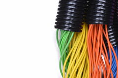 Electric cables in corrugated plastic pipes. On metal surface Stock Photography