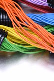Electric cables in corrugated plastic pipes. On metal surface Stock Images