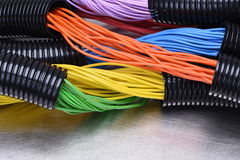 Electric cables in corrugated plastic pipes. On metal surface Royalty Free Stock Photography