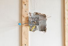 Electric cables and terminal  gang box. Inside a dry wall Stock Photo