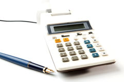 Electric calculator and blue fountain-pen Stock Photos
