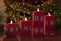 Electric candles with christmas decorations in atmospheric light Royalty Free Stock Photo