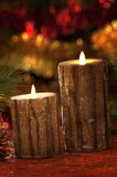 Electric candles with christmas decorations in atmospheric light Royalty Free Stock Photography
